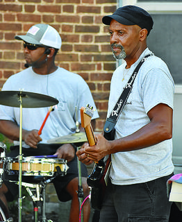 Steve Compton (right) plays the bass guitar, while Greg Thornton plays the drums for the band.