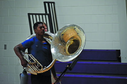 CHS junior Zaquan Cowan carries his equipment into the gym, ready to start practice.