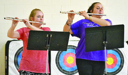 CHS junior Emily Hayden (left) and freshman Kadence Houk practice in the high school gym during the opening day of band camp. See more photos on Page A8.