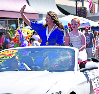 Elizabeth Sullivan, the Distinguished Young Woman of Taylor County, rides in Thursday's parade with her little sister, Avery Cox.