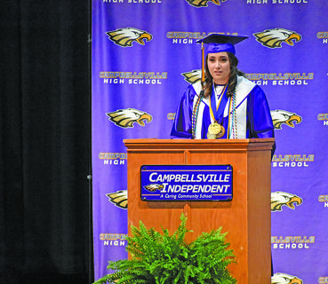 "Elizabeth Sullivan, valedictorian, gives her speech on how society narrowly defines 'smart' as someone with a high GPA, saying ""one word should not make you mutilate your self-love and self-confidence, but that is how the world plays its game. We will fail so we can grow and learn. We will be told we aren't good enough and have doors shut in our faces. If you hold on to the talents that God has given you and brave the storms... You will find greatness."""