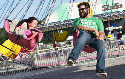 Isabelle and Alex Myers enjoy the swings at the Taylor County Fair.