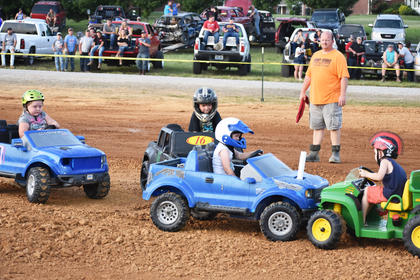 Children participate in the Power Wheels Derby at the Taylor County Fair.