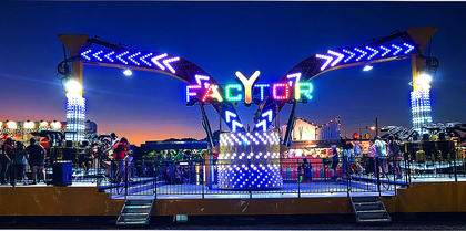 Fairgoers enjoy a ride on Y Factor, one of the James Gang Midway rides at the Taylor County Fair.