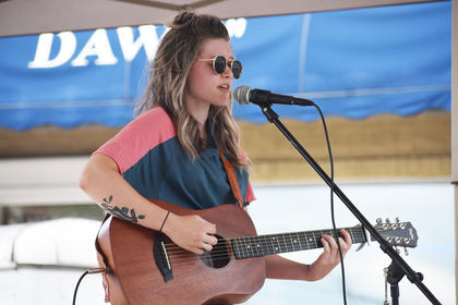 Kayla Estes of Campbellsville performs at Folk Fest in Downtown Campbellsville Saturday afternoon.