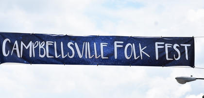 The Campbellsville Folk Fest banner flies above Main Street