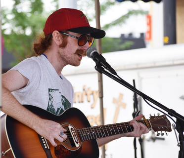 Lucas Stephens performs at Folk Fest last Saturday.