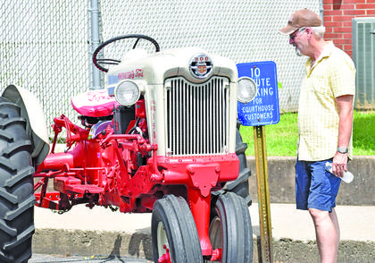 A gentleman checks out a Ford 900 tractor that was parked behind the Taylor County Courthouse Thursday following the Fourth of July parade.