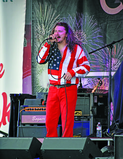 T.J. Lyle, the lead singer of the Georgia Thunderbolts, gets the crowd fired up at Party in the Park, where the band opened for the Kentucky Headhunters.