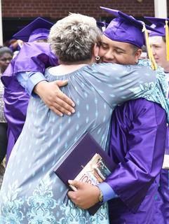 CHS graduating senior Adrian Cravens embraces his mother, Stephanie Cravens, following graduation ceremonies at Campbellsville HIgh School.