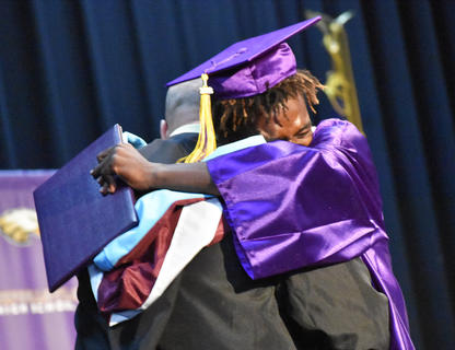 CHS senior Jonta Strawther hugs CHS Principal David Petett at the CHS Graduation.