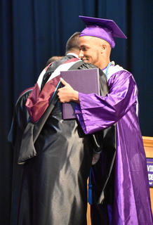 CHS Senior Ethan Lay hugs CIS Superintendent Kirby Smith.