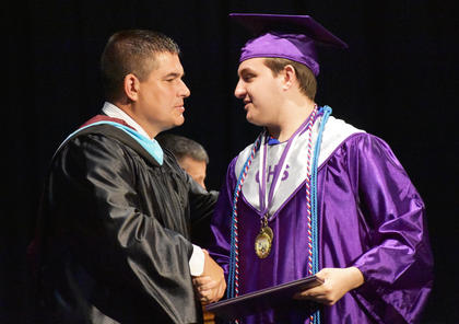 CHS Senior Austin Fitzgerald shakes hands with CIS Superintendent Kirby Smith.