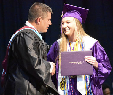 CHS Senior Madison Dial shakes hands with CIS Superintendent Kirby Smith.