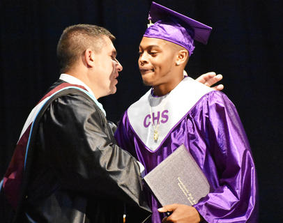 CHS senior Devonte Cubit receives his diploma at graduation Saturday morning.