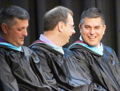 "CHS Asst. Principal Mark ""Shiny"" Kearney, CHS Guidance Counselor Richard Dooley, and CIS Superintendent share a laugh at CHS graduation."