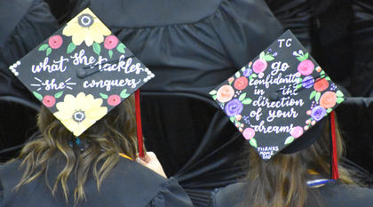 Several students decorated and personalized their caps for graduation.