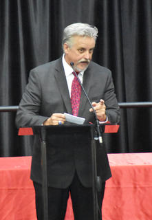 Taylor County Schools Superintendent Roger Cook addresses the audience at Friday night's graduation ceremony.