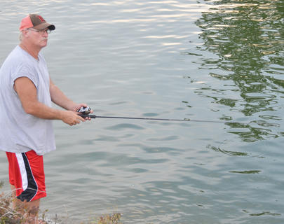 Tim Burton of Greensburg sees if the fish are biting near the state park boat ramp.