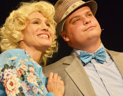 Miss Adelaide, played by Robin Humphress of Campbellsville, smiles as her fiancé, gambler Nathan Detroit, portrayed by Jody Graham of Campbellsville, says he will marry her, but he just doesn't know when.