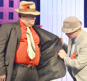 Nathan Detroit, played by Jody Graham of Campbellsville, sees if notorious gambler Big Jule, played by Dr. Mark Bradley of Campbellsville, has brought a gun to the night's crap game. He did.