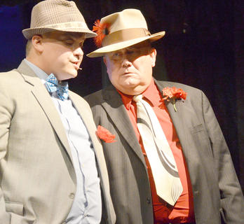 Notorious gambler Big Jule, played by Dr. Mark Bradley of Campbellsville, frowns as he learns gambler Nathan Detroit, played by Jody Graham of Campbellsville, says he doesn't know where the nightly craps game will be.