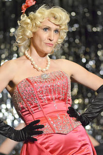 """Miss Adelaide, played by Robin Humphress of Campbellsville, sings """"Take Back Your Mink"""" with the Hot Box Girls."""