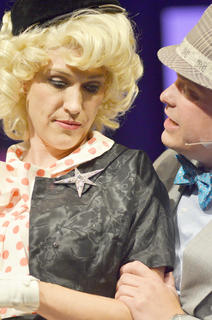 Miss Adelaide, played by Robin Humphress of Campbellsville, at left, is sad after her long-time fiancé and gambler Nathan Detroit, played by Jody Graham of Campbellsville, tells her he doesn't know when they will get married.