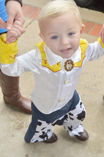 "Kendall Graham, 2, of Campbellsville, dresses as Jessie from ""Toy Story"" as she trick-or-treats on Main Street."