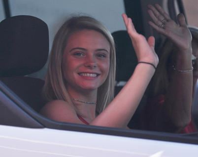 Hannah Willis waves to the crowd as she participates in Wednesday's 4th of July parade.