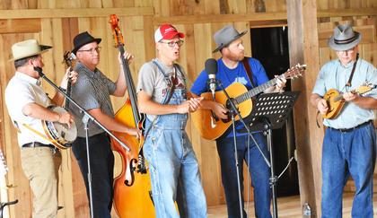The Exie Boys provide music entertainment in the historic bank barn at the Homeplace on Green River.