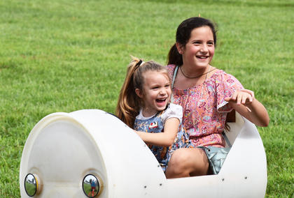 Keira Gadberry and Amiah Carmicle of Campbellsville enjoy a ride on the barrel train at the Homeplace on Green River.