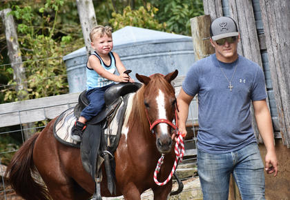 Honor Lancaster, 2, of Campbellsville, rides a horse at the Homeplace on Green River.