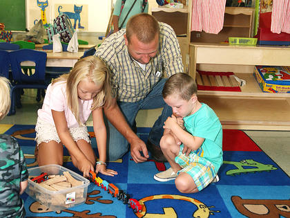 Taylor County Elementary preschooler Mason Milby, age 3, right, settles into his new class with some help from his sister, Ella, a 7-year-old third-grader, and their dad, Kyle.