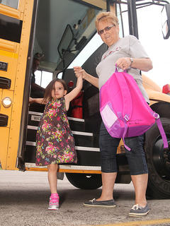 Melissa Lawson, a 24-year employee of the Taylor County School District, greets kindergartener Jordan Slinker as she arrives at school on Wednesday.