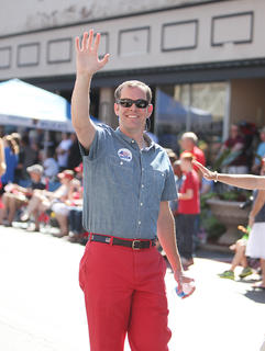 Max Wise, newly elected 16th District state senator, waves to the crowd during the parade.