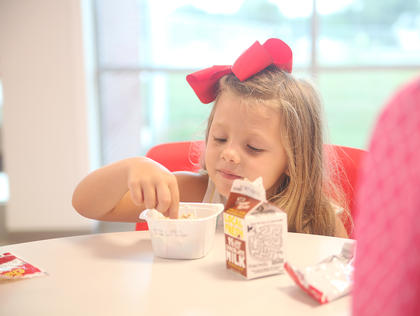 Tinsley Altman, 5, eats breakfast before starting her first day of kindergarten at Taylor County Elementary School.