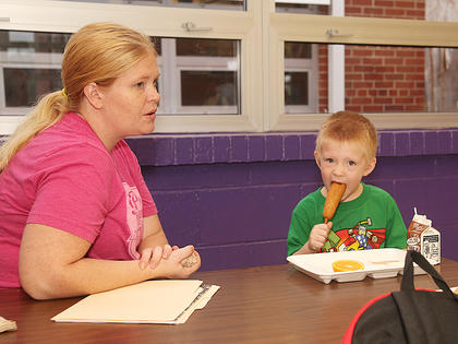 Gage Henderson, a 4-year-old kindergartener at Campbellsville Elementary School, enjoys breakfast with his mom, Stephanie Sims, Wednesday morning.