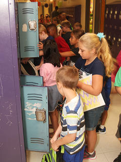 Campbellsville Elementary School students place items in their lockers on the first day of school Wednesday.
