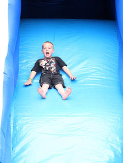 Zaccheus Fields, 5, of Greensburg, enjoys a trip down an inflatable slide at Kids Outdoor Day at Green River Lake State Park.