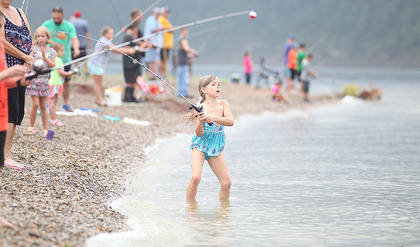 Madison Burton, 7, of Cox's Creek, prepares to cast her line in Saturday's Kids Fishing Derby at Green River Lake State Park.