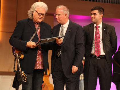 Bluegrass legend Ricky Skaggs was presented a certificate declaring him a Campbellsville University Honorary Alumnus by CU President Dr. Michael Carter. Skaggs and his band, Kentucky Thunder, performed in concert at CU Thursday. The concert was a fundraising event for the university, and it brought more than $25,000, which will go toward the university's scholarship fund.