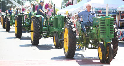 Taylor County's agricultural history was on display as tractors of all ages lined Main Street during the Fourth of July parade on Friday.