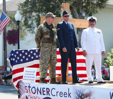 Representatives of the U.S. Army, U.S. Air Force, and U.S. Navy ride on the Stoner Creek Church float during the parade.