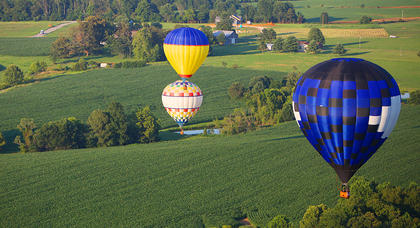 Hot air balloons drift across the landscape of Taylor County on the Fourth of July.