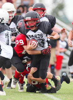 Landon Wood runs the ball against Washington County in Saturday's youth league football action.