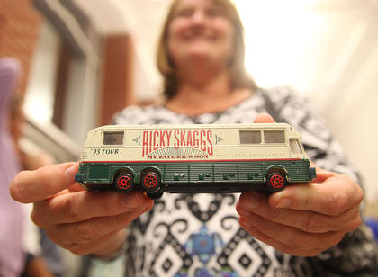 Teresa Elmore shows off a 1993 Ricky Skaggs toy tour bus she brought to the concert Thursday night on the campus of Campbellsville University. Elmore said she bought the bus for her then-young son in 1993, and had kept it in her office. Following the concert, she had the opportunity to meet Skaggs and have him sign the top of the bus, which he gladly did.