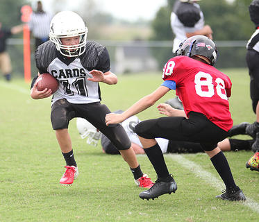 Cross Watson carries the ball for Taylor County during Saturday's youth league football action in Washington County.