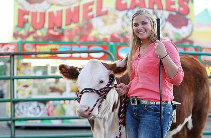 Kailey Thompson is all smiles before the cattle show.