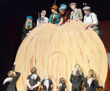 """Kentucky Classic Theatre staged """"James and the Giant Peach"""" in Lebanon last week, featuring children from Taylor and surrounding counties. Robin Humphress of Campbellsville is directing the play, which will also be performed Friday and Saturday at 7 p.m. at Angelic Hall. Above, from left, Jane Palagi plays Spider, Nicholas McCann portrays Earthworm, Andy O'Daniel is Grasshopper, Shelby Hayden is Ladybird, Ally Howard is James and Alexis Hayden plays Centipede as they ride atop a giant peach while being attacked by sharks."""